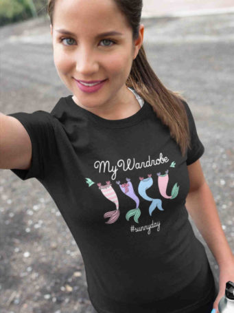 6S1064 pretty girl in black tshirt with Mermaid tails on clothesline