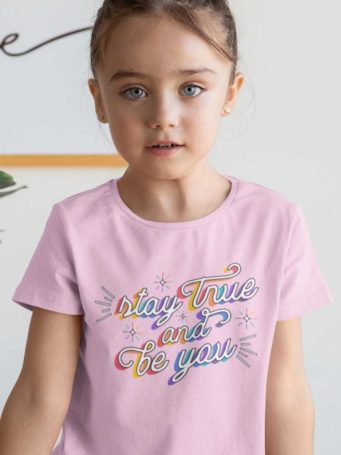sweet girl in a light pink tshirt with Stay True Be You