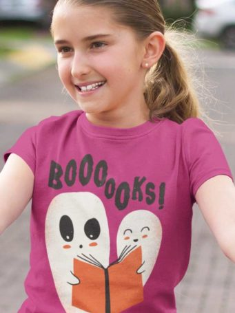 6S1219 young girl in a dark pink tshirt with Ghosts reading a book